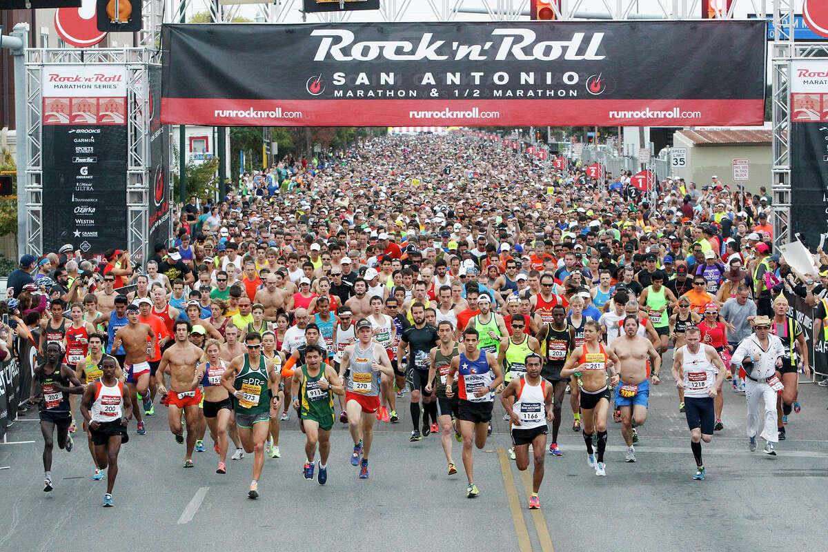 Runners leave the starting line of the Rock 'n' Roll San Antonio Marathon and 1/2 Marathon on Sunday, Nov. 17, 2013. MARVIN PFEIFFER/ mpfeiffer@express-news.net