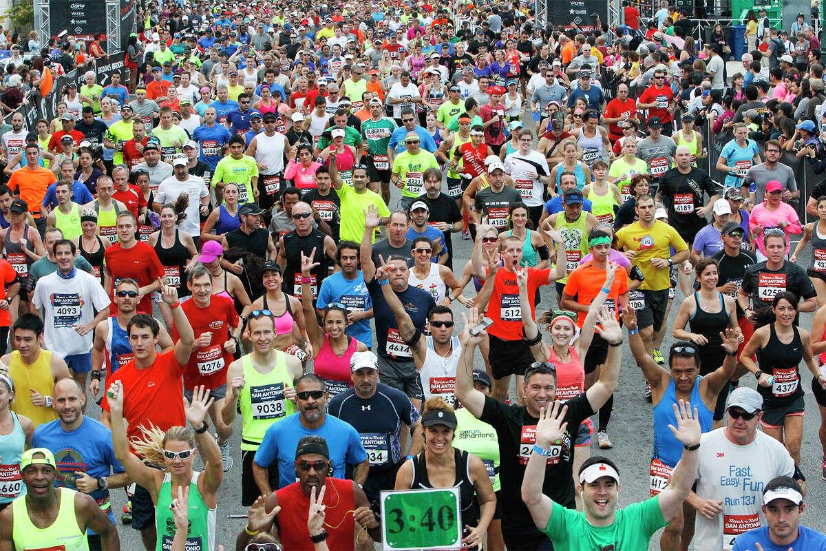 Runners take off at the start of the Rock 'n' Roll San Antonio Marathon and 1/2 Marathon on Sunday, Nov. 17, 2013. MARVIN PFEIFFER/ mpfeiffer@express-news.net
