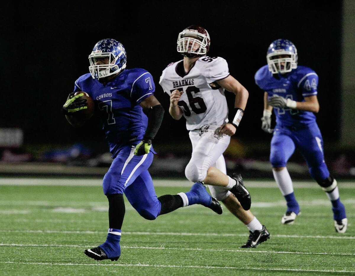 Edna's Marquis Broussard rushes for a 91 yard score in the second quarter during a Class 4A Division II Region IV high school playoff game between Edna and Hallettsville on Friday, December 5, 2014. (Bob Levey/For The Chronicle)