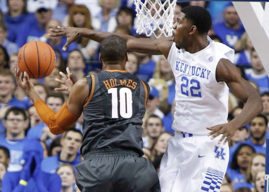 Texas' Jonathan Holmes (10) shoots under pressure from Kentucky's Alex Poythress (22) during the first half of an NCAA college basketball game, Friday, Dec. 5, 2014, in Lexington, Ky. (AP Photo/James Crisp) Photo: James Crisp, FRE / Associated Press / FR6426 AP