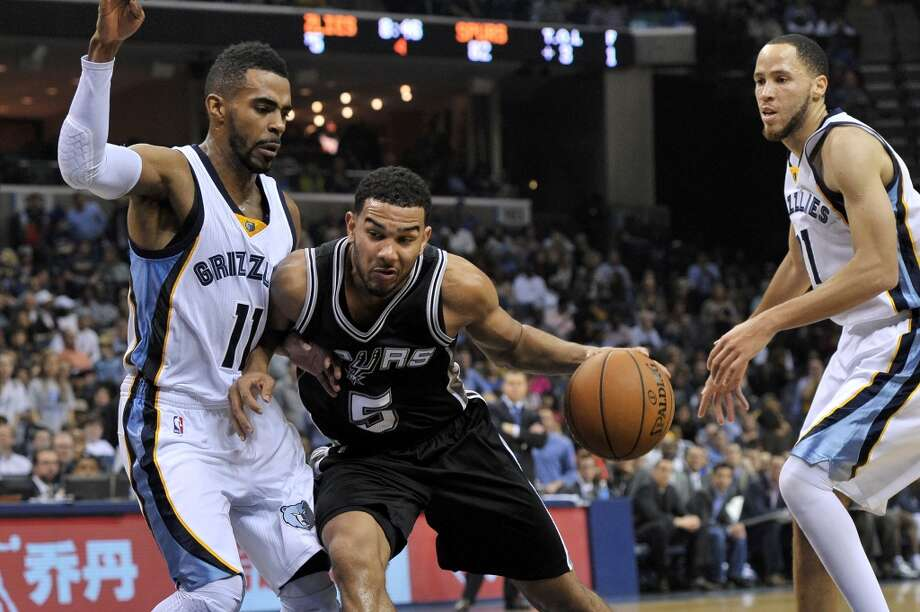 San Antonio Spurs guard Cory Joseph (5) works for position against Memphis Grizzlies guard Mike Conley (11 )in the second half of an NBA basketball game Friday, Dec. 5, 2014, in Memphis, Tenn. The Spurs beat the Grizzlies 107-101. (AP Photo/Brandon Dill) Photo: AP