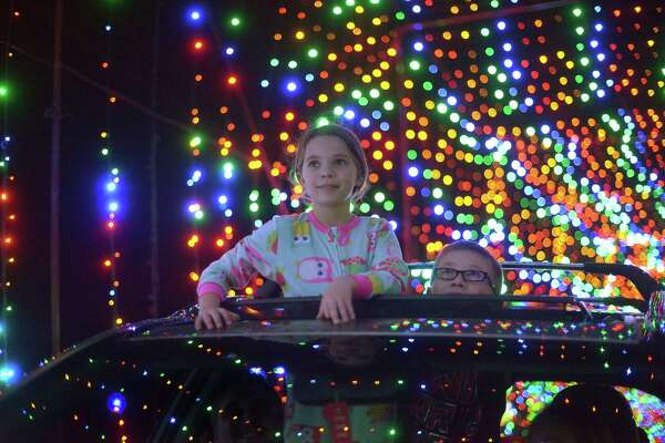 "Mykala Jones and her younger brother, Micah attend the ""Christmas Lights Fest"" holiday display at the Don Strange Ranch on Thursday, Dec. 4, 2014. The display of over 2 million lights will be available for viewing until January 3. The ranch is located just north of Boerne off of Interstate 10 near Waring. ""I like the lights because there's a bunch of them and you can drive through,"" Mykala said."