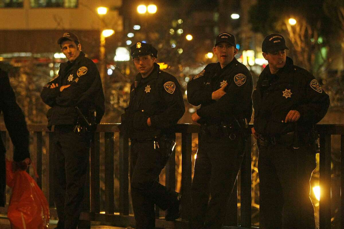 Police stand by at Powell and Market streets before a protest in San Francisco, Calif. Friday, December 5, 2014 against the shooting of Michael Brown in Ferguson, Missouri and the chokehold death of Eric Garner in New York City