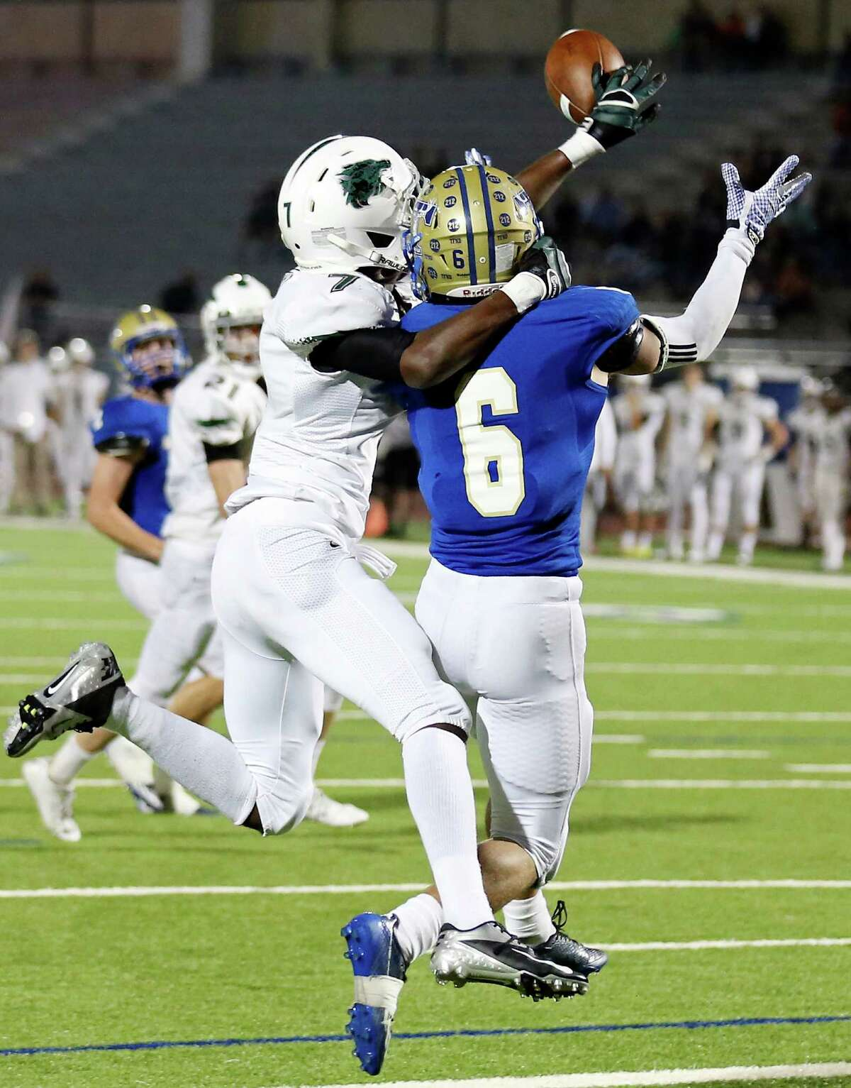 Cedar Park's Elisha Guidry blocks a pass intended for Kerrville Tivy's Carson McCoy during first half action of their Class 5A Division II state quarterfinal playoff game Friday Dec. 5, 2014 at Alamo Stadium.