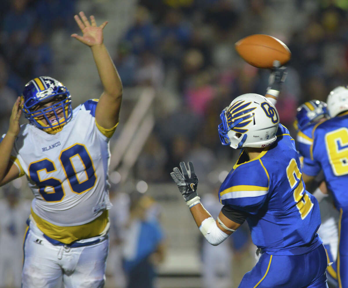 Blanco's Joe Lopez tries to block a pass by Odem's C. J. Romewro during their Class 3A Division II playoff game at Comalander Stadium Friday.