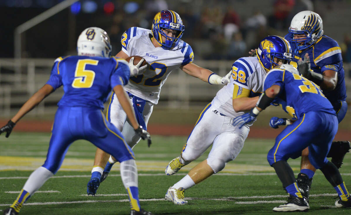 Blanco's Colton Elrod looks for running room against Odem in a 3A Division II playoff game at Comalander Stadium.