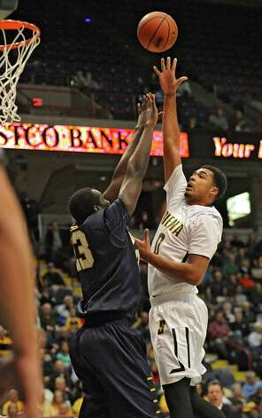 Siena's Javion Ogunyemi goes up for a basket during a basketball game against Quinnipiac at the Times Union Center on Friday, Dec. 5, 2014 in Albany, N.Y. (Lori Van Buren / Times Union) Photo: Lori Van Buren / 00029714A