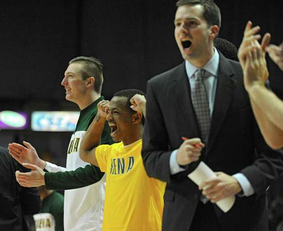 Siena's bench screams with joy after a great shot by their teammate during a basketball game against Quinnipiac at the Times Union Center on Friday, Dec. 5, 2014 in Albany, N.Y. (Lori Van Buren / Times Union) Photo: Lori Van Buren / 00029714A