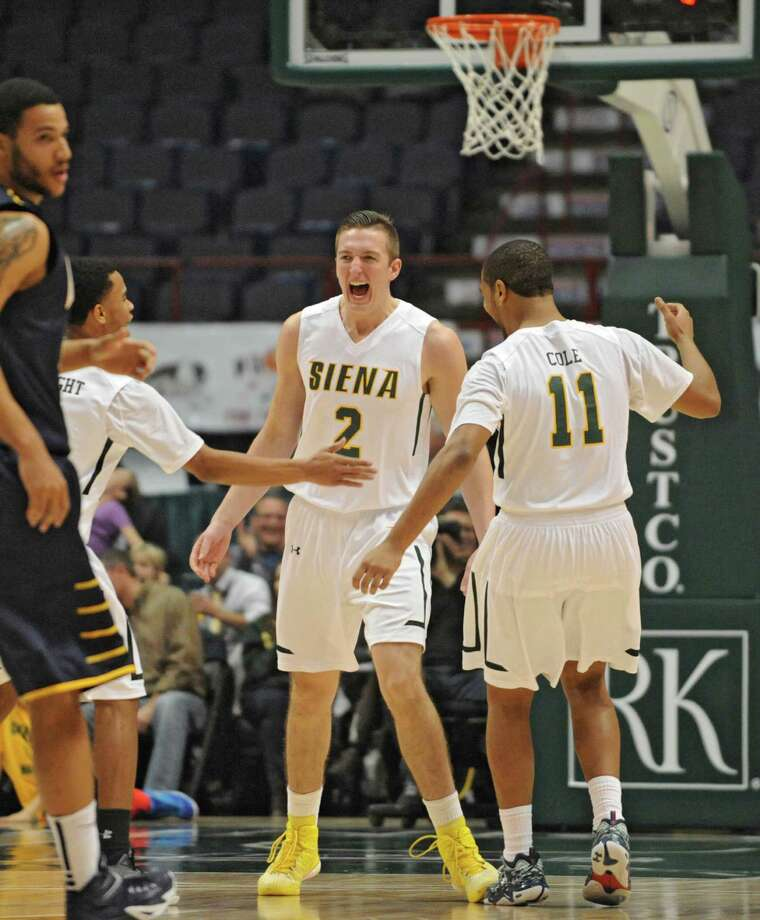 Siena's Willem Brandwijk show his excitement after making a key basket during a basketball game against Quinnipiac at the Times Union Center on Friday, Dec. 5, 2014 in Albany, N.Y. (Lori Van Buren / Times Union) Photo: Lori Van Buren / 00029714A
