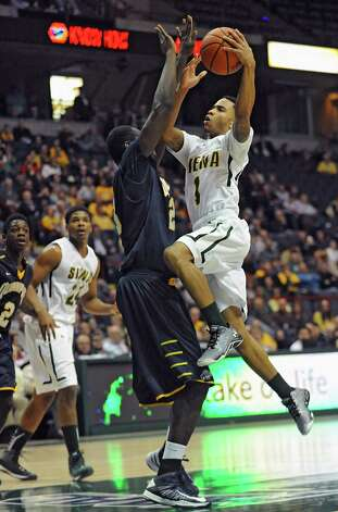 Siena's Marquis Wright drives to the hoop during a basketball game against Quinnipiac at the Times Union Center on Friday, Dec. 5, 2014 in Albany, N.Y. (Lori Van Buren / Times Union) Photo: Lori Van Buren / 00029714A