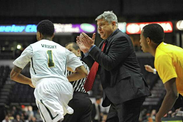 Siena head coach Jimmy Patsos claps after Marquis Wright scores during a basketball game at the Times Union Center on Friday, Dec. 5, 2014 in Albany, N.Y. (Lori Van Buren / Times Union) Photo: Lori Van Buren / 00029714A