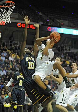 Siena's Marquis Wright, right, fouls Quinnipiac's Alain Chigha as he drives to the basket during a basketball game at the Times Union Center on Friday, Dec. 5, 2014 in Albany, N.Y. (Lori Van Buren / Times Union) Photo: Lori Van Buren / 00029714A