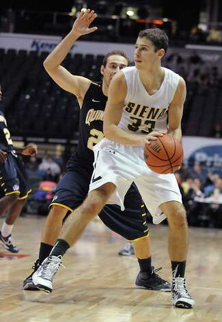 Siena's Rob Poole looks for an open man during a basketball game against Quinnipiac at the Times Union Center on Friday, Dec. 5, 2014 in Albany, N.Y. (Lori Van Buren / Times Union) Photo: Lori Van Buren / 00029714A
