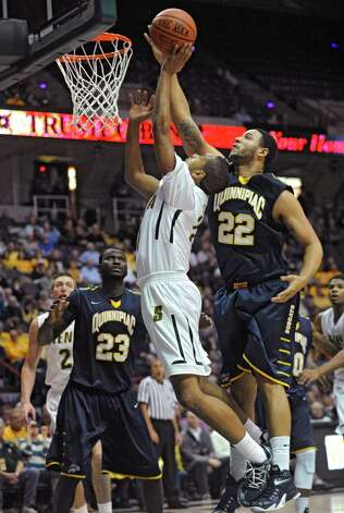 Siena's Patrick Cole is guarded by Quinnipiac's Justin Harris, #22, during a basketball game at the Times Union Center on Friday, Dec. 5, 2014 in Albany, N.Y. (Lori Van Buren / Times Union) Photo: Lori Van Buren / 00029714A