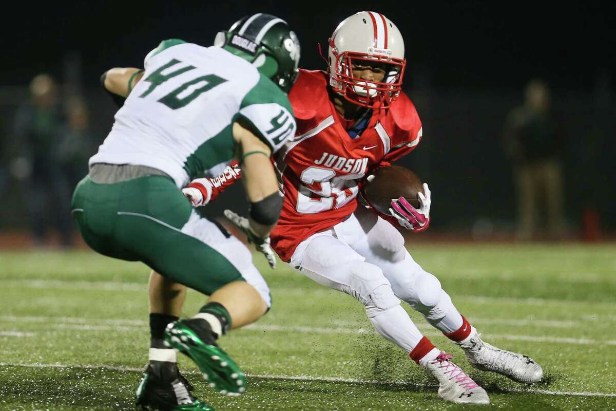 Judson's Christian Guillory (right) tries to get past Reagan's Brucks Saathoff during the second half of their Class 6A Division I state quarterfinal game at Rutledge Stadium on Friday, Dec. 5, 2014. Judson beat the Rattlers 34-24.