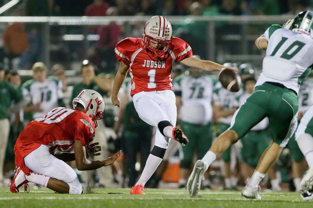 Judson's Mortiz Zaher (center) kicks a 39-yard field goal during the second quarter of their Class 6A Division I state quarterfinal game with Reagan at Rutledge Stadium on Friday, Dec. 5, 2014. Zaher added another 39-yarder in the second half.