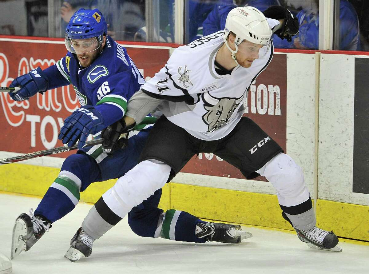 San Antonio Rampage center Steven Hodges (11) tangles with Utica Comets center Wacey Hamilton in the second period of an AHL hockey game, Friday, Dec. 5, 2014, in San Antonio.