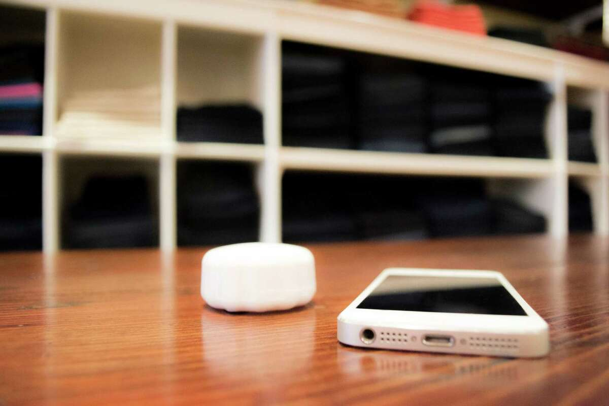 Beacons, smaller than smartphones, can hang on walls or be placed on machines and communicate with phones via Bluetooth signals.
