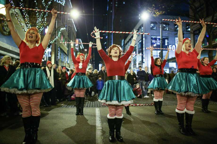 "The ""Sugarplum Elves"" perform during the Great Figgy Pudding Caroling Competition. Thousands of people came to downtown Seattle to watch caroling groups compete and raise funds for the Pike Market Senior Center & Food Bank. Photographed on Friday, December 5, 2014. Photo: JOSHUA TRUJILLO, SEATTLEPI.COM / SEATTLEPI.COM"