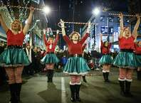 The Sugarplum Elves perform during the Great Figgy Pudding Caroling competition. Thousands of people came to downtown Seattle to watch caroling groups compete and raise funds for the Pike Market Senior Center & Food Bank. Photographed on Friday, December 6, 2014.