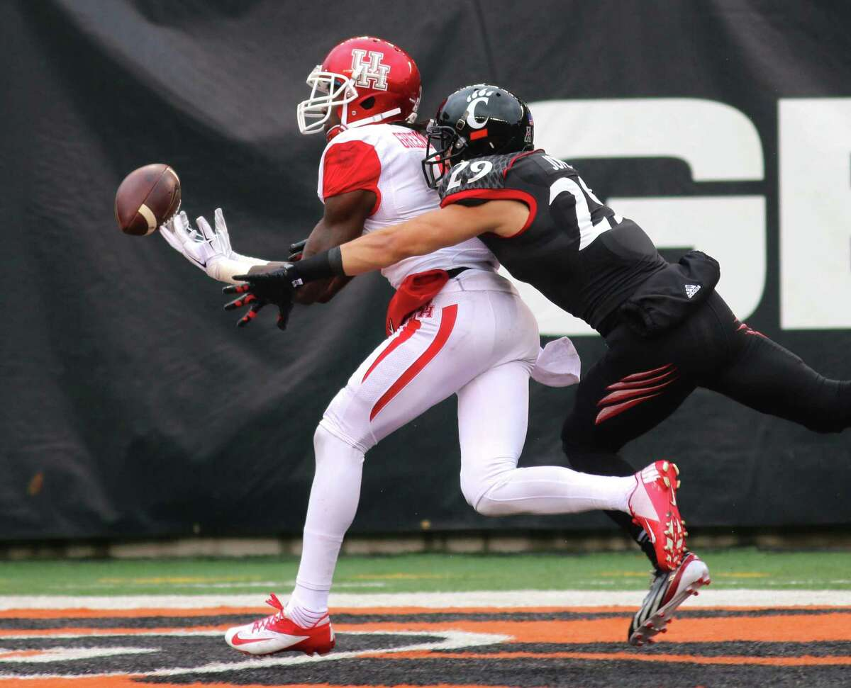 Dec. 6: Cincinnati 38, Houston 31Record: 7-5Cincinnati's Andre Jones keeps Houston's Deontay Greenberry from catching a touchdown pass during the first half of an NCAA college football game Saturday Dec. 6, 2014, in Cincinnati. (AP Photo/Tom Uhlman)