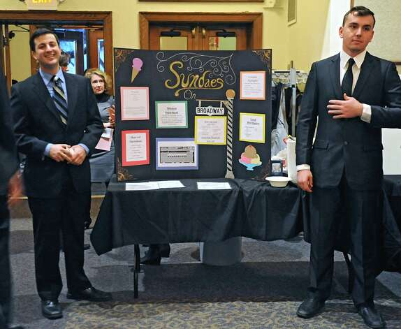 Junior Michael Honeywell of Albany and Sophomore Michael Orso of Catskill stand next to their team's business Sundaes on Broadway as teams of students from The College of Saint Rose offer presentations on what kinds of businesses downtown Albany needs at the Saint Joseph Hall Auditorium on Wednesday, Nov. 3, 2014 in Albany, N.Y. (Lori Van Buren / Times Union) Photo: Lori Van Buren / 00029685A