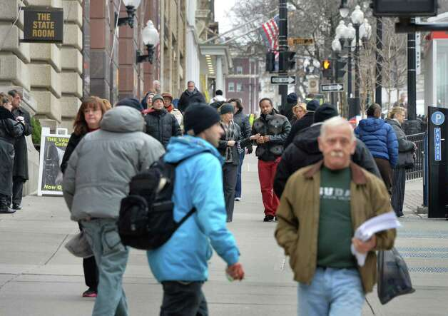 Pedestrians crowd the sidewalk on State Street Friday Dec. 5, 2014, in Albany, NY.  (John Carl D'Annibale / Times Union) Photo: John Carl D'Annibale