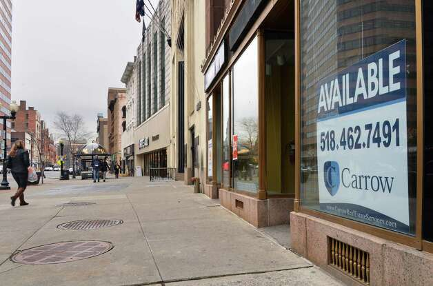 Empty storefront, right, at 7 North Pearl Street Friday Dec. 5, 2014, in Albany, NY.  (John Carl D'Annibale / Times Union) Photo: John Carl D'Annibale