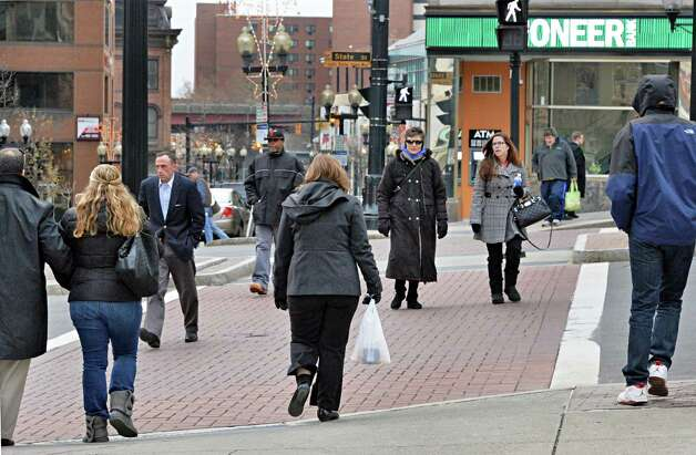 Pedestrians crowd the crosswalk at State and North Pearl Streets Friday Dec. 5, 2014, in Albany, NY.  (John Carl D'Annibale / Times Union Photo: John Carl D'Annibale