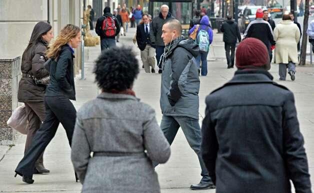 Pedestrians crowd the sidewalk on North Pearl Street Friday Dec. 5, 2014, in Albany, NY.  (John Carl D'Annibale / Times Union) Photo: John Carl D'Annibale