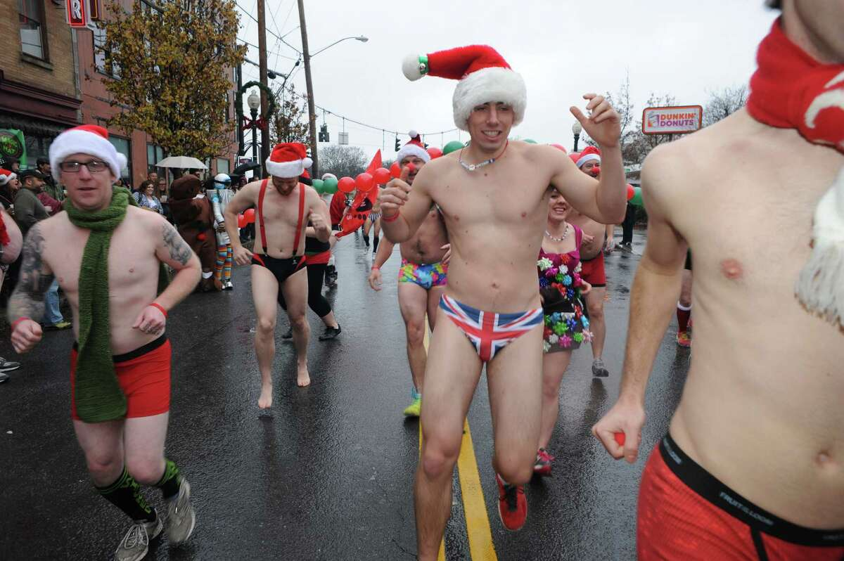 Runners break from the starting line during the 2014 Santa Speedo Sprint in conjunction with Winter Wonderlark on Saturday Dec. 6, 2014 in Albany, N.Y. (Michael P. Farrell/Times Union)