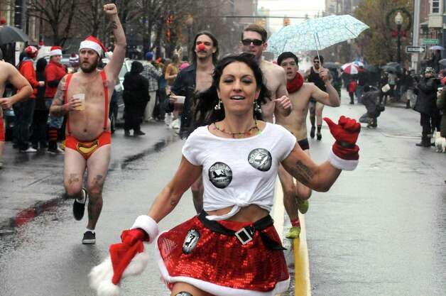 Chelsea Barraco of Albany was the first women finisher in the 2014 Santa Speedo Sprint in conjunction with Winter Wonderlark on Saturday Dec. 6, 2014 in Albany, N.Y.  (Michael P. Farrell/Times Union) Photo: Michael P. Farrell / 00029715A