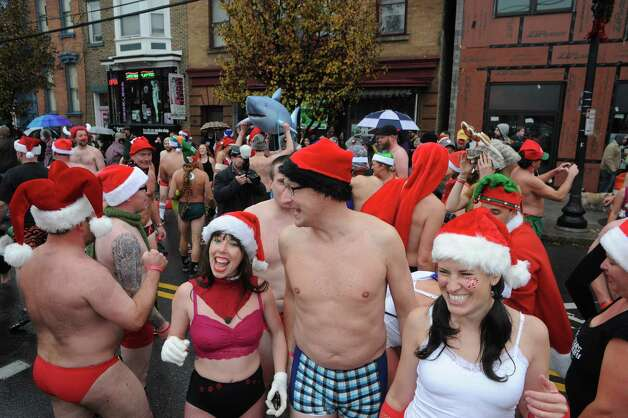 Runners congregate at the finishline during the 2014 Santa Speedo Sprint in conjunction with Winter Wonderlark on Saturday Dec. 6, 2014 in Albany, N.Y.  (Michael P. Farrell/Times Union) Photo: Michael P. Farrell / 00029715A