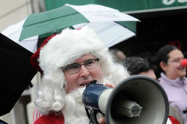 Albany County Legislator Chris Higgins dressed as Santa keeps the order during the 2014 Santa Speedo Sprint in conjunction with Winter Wonderlark on Saturday Dec. 6, 2014 in Albany, N.Y.  (Michael P. Farrell/Times Union) Photo: Michael P. Farrell / 00029715A