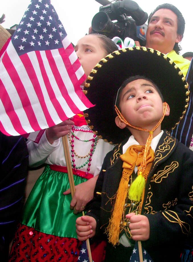 Luis Jesus Maya Padilla, 6, from Colegio, Mexico, participates in the Hands Across the Bridge ceremony between Brownsville and Matamoros, Mexico. Photo: LIZA LONGORIA, MBR / THE BROWNSVILLE HERALD
