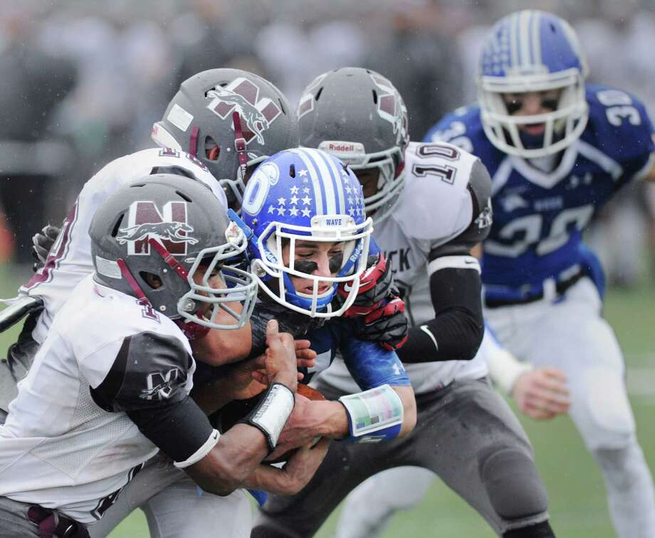 At center, Darien running back Shelby Grant carries a group of Naugatuck defenders including Antoine Sistrunk (#1), left, and Etty Ilunga (#10), across the goal-line to score a touchdown during the Class L high school football semi-final betweeen Darien High School and Naugatuck High School at Darien, Conn., Saturday, Dec. 6, 2014. Looking on for Darien at right is Todd Herget (#30). Darien advanced to the final with a 42-12 victory over Naugatuck. Photo: Bob Luckey / Greenwich Time