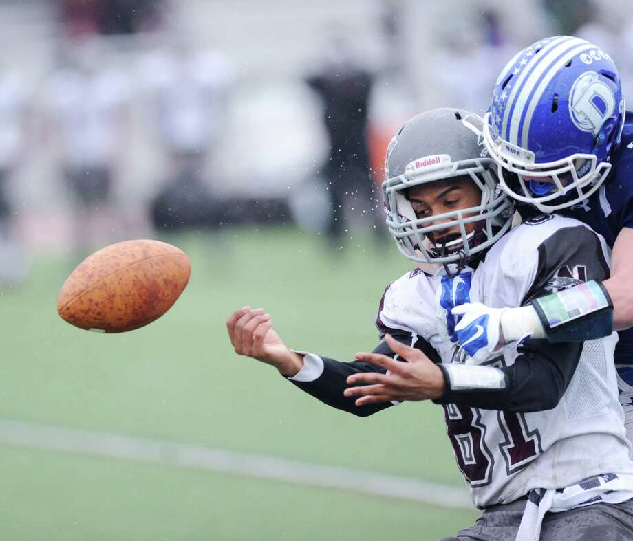 At left, Naugatuck receiver C.J. Wall (#81) can not make the catch as Darien defender Hudson Hamill (#22) breaks up the reception on a hit during the Class L high school football semi-final betweeen Darien High School and Naugatuck High School at Darien, Conn., Saturday, Dec. 6, 2014. Darien advanced to the final with a 42-12 victory over Naugatuck. Photo: Bob Luckey / Greenwich Time
