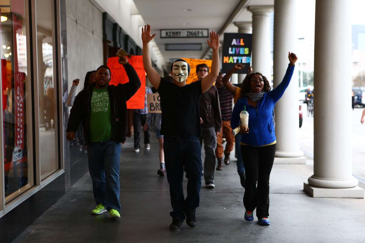 Protestors demonstrate outside of a store near the Galleria in Houston on Dec. 6, 2014.