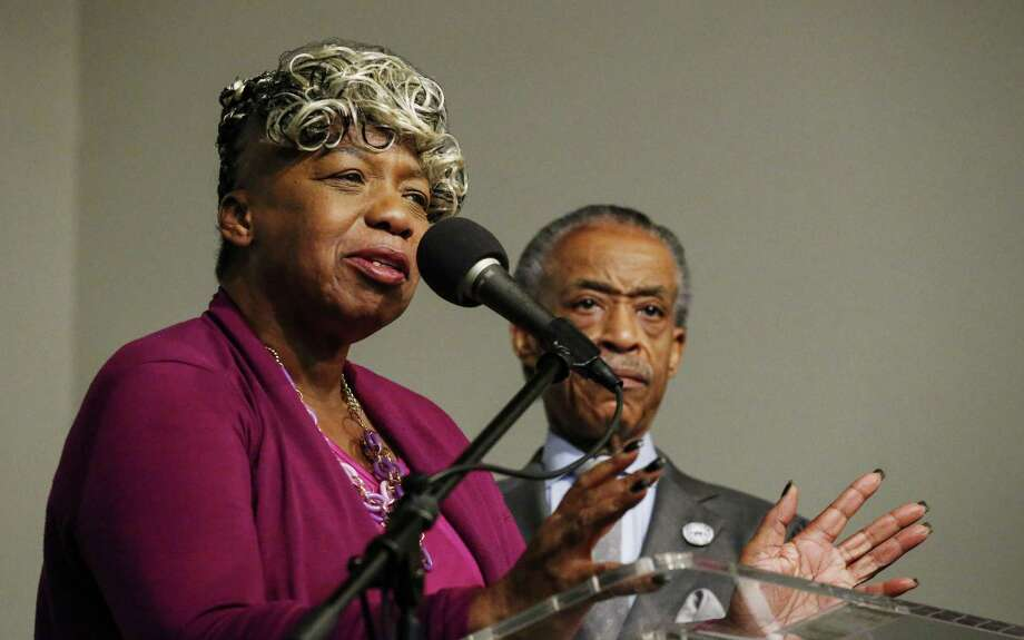 Eric Garner's mother, Gwen Carr, speaks in New York City next to the Rev. Al Sharpton, who is planning a march in Washington, D.C., next Saturday. Photo: Kena Betancur / Getty Images / 2014 Getty Images