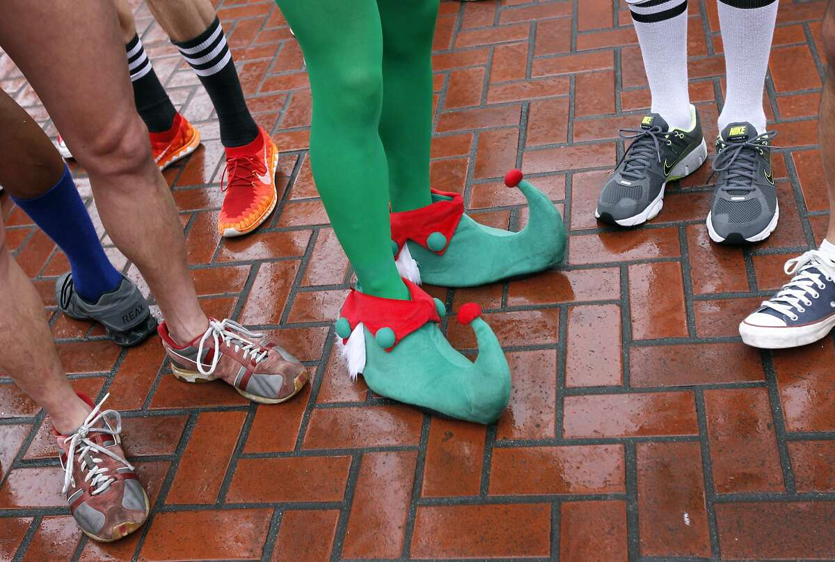 Sean Cretella chose elf footwear for the Santa Skivvies Run in San Francisco, Calif. on Saturday, Dec. 6, 2014. Participants in the 5th annual event organized by the San Francisco AIDS Foundation were encouraged to don holiday apparel or strip down to their underwear and run 1.6 miles up Market Street from UN Plaza to Noe Street in the Castro.