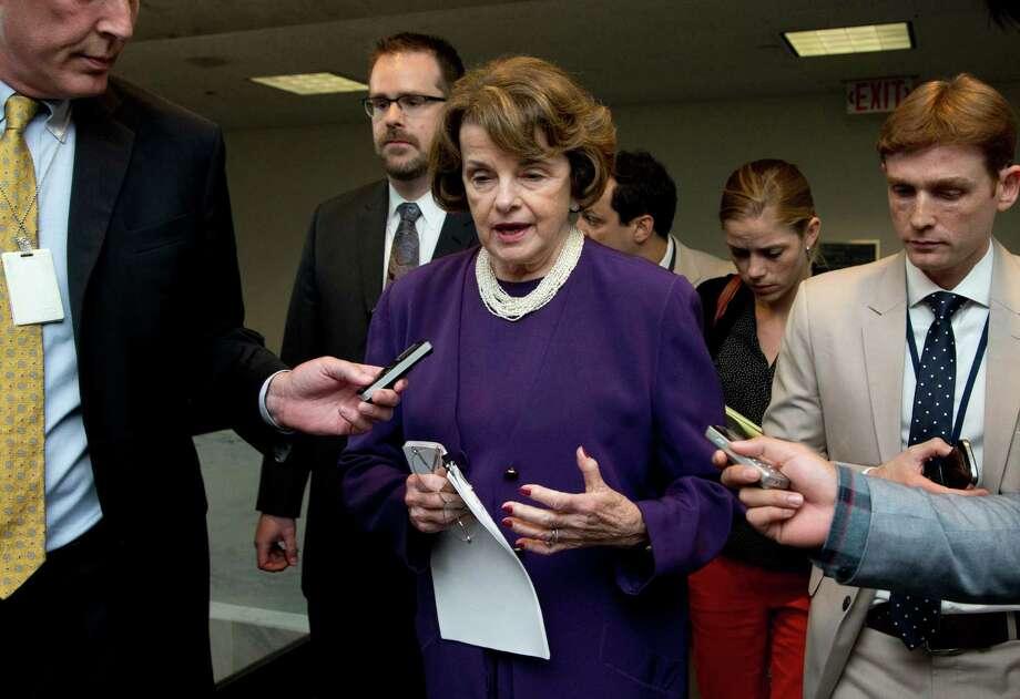 Sen. Dianne Feinstein with reporters on Capitol Hill in June. Photo: Manuel Balce Ceneta / Manuel Balce Ceneta / Associated Press / AP