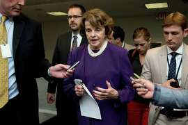Sen. Dianne Feinstein with reporters on Capitol Hill in June.