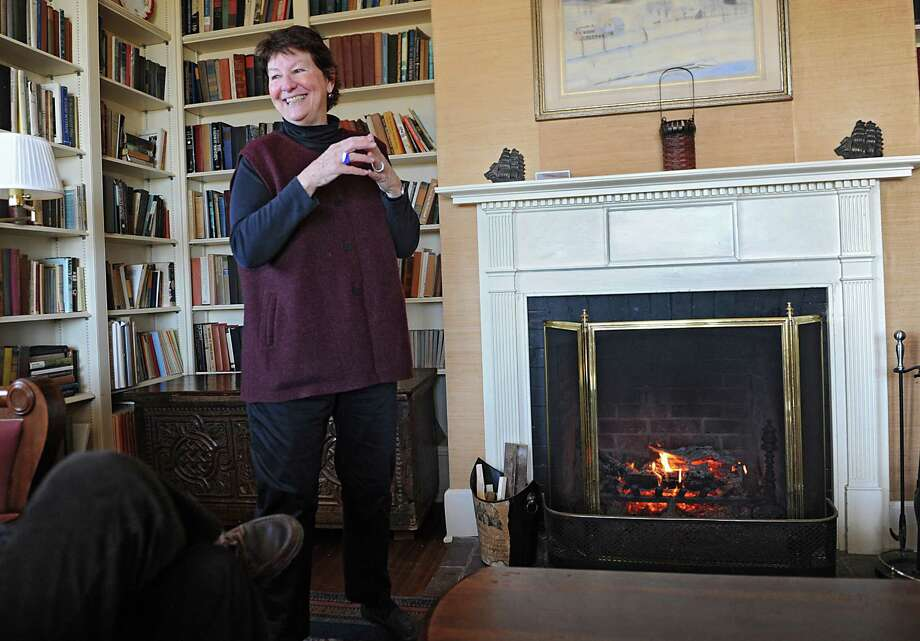 Carol Ash, director, talks about the history of the Carey Institute for Global Good as she stands next to a warm fire in the Huyck House on the grounds of the institute on Wednesday, Nov. 19, 2014 in Rensselaerville, N.Y.  (Lori Van Buren / Times Union) Photo: Lori Van Buren / 00029506A