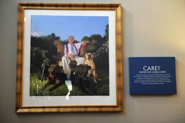 A photograph of Bill Carey and his dogs is displayed in the Guggenheim Pavilion at the Carey Institute for Global Good on Wednesday, Nov. 19, 2014 in Rensselaerville, N.Y.  (Lori Van Buren / Times Union) Photo: Lori Van Buren / 00029506A