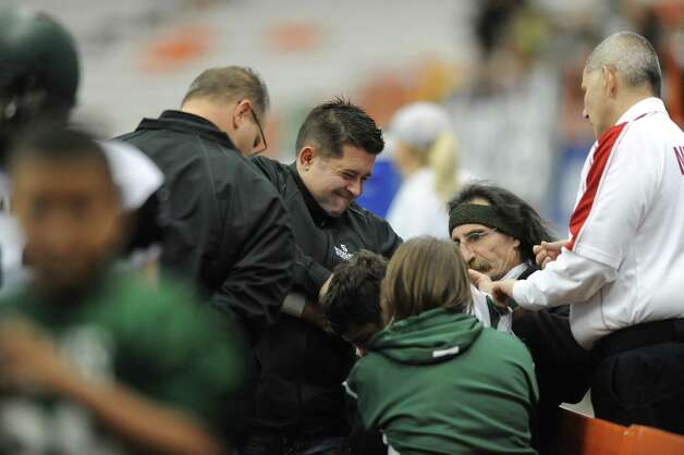 Schalmont's quarterback Nick Gallo gets assistance from trainers after being injured Sunday Nov. 30, 2014, during the Class B state football final against Maine-Endwell at the Carrier Dome in Syracuse, N.Y. (Cindy Schultz / Times Union)