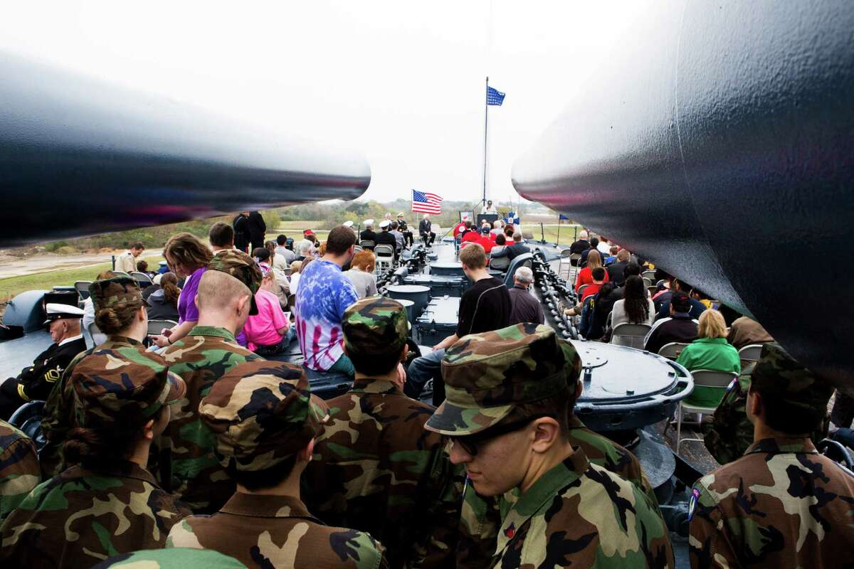 Cadets as well as family and friends gathered at the Battleship Texas to honor the survivors and victims of the attack against Pearl Harbor 73 years ago. Saturday, Dec. 6, 2014, in La Porte.