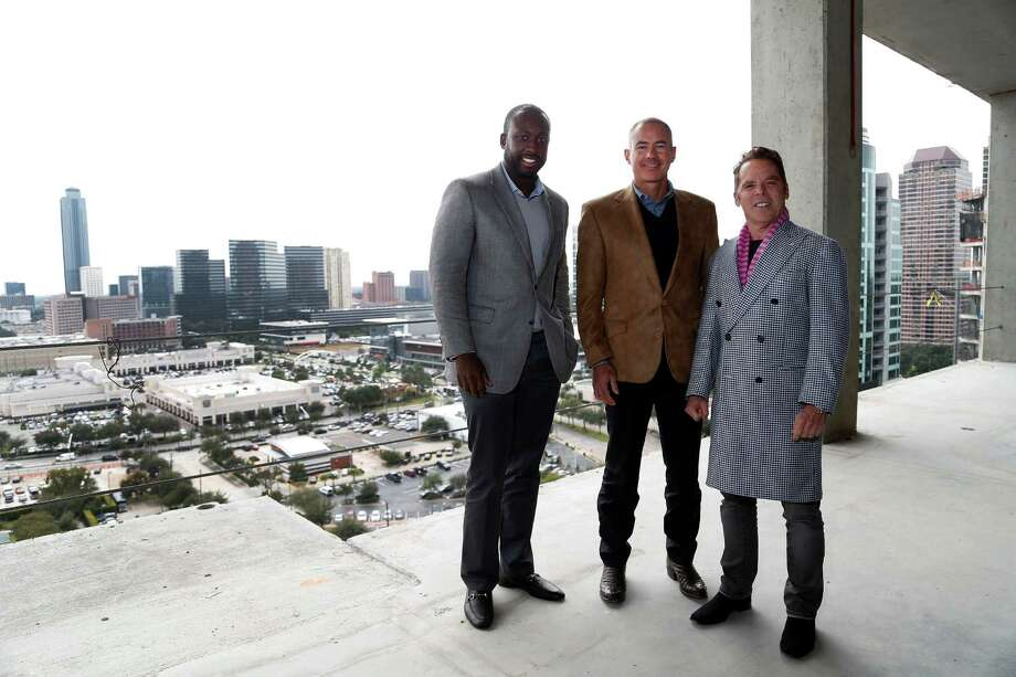 Acho Azuike, left, Roberto Contreras and Randall Davis expect the Galleria-area luxury tower Astoria to be completed next year. Foreigners seeking green cards have played a major role in financing it. Photo: Karen Warren, Staff / © 2014 Houston Chronicle