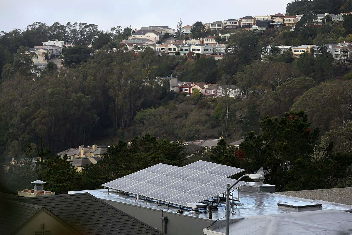 Solar panels seen on the roof of a Twin Peaks home in San Francisco, Calif., on Thursday, December 4, 2014. San Francisco may soon pass a program that will give city homeowners and businesses a creative way to finance the installation of solar panels as well as water and energy efficient projects.