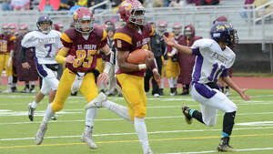 St. Joe's Mufasha Abdul Basir scores a touchdown as St. Joseph High School challenges Ellington/Somers High School in the Class M Small Division varsity football playoffs at Trumbull High School, in Trumbull, CT on Sat. Dec. 6, 2014.