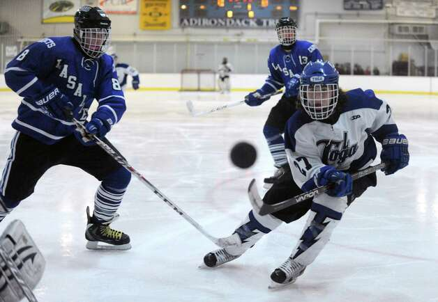 Saratoga's JT Rafferty, right, and LaSalle's Brendan Haverty, left, go after the puck during thier boy's high school hockey game on Wednesday Jan. 22, 2014 in Saratoga Springs, N.Y.  (Michael P. Farrell/Times Union) Photo: Michael P. Farrell / 00025435A